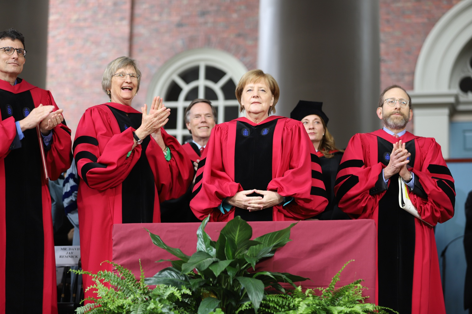 The crowd gives a standing ovation to German Chancellor Angela Merkel as she is introduced as the recipient of an honorary degree.