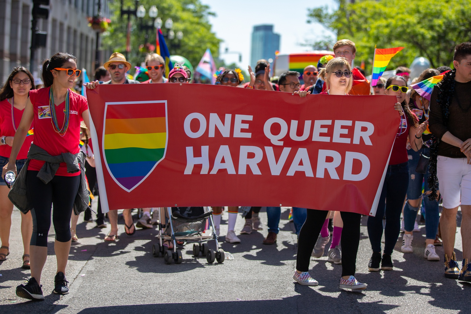 """A group of Harvard students marched down Boylston Street as a part of the Boston Pride Parade last Saturday afternoon. This year's theme was """"Looking Back, Loving Forward"""" in celebration of the 50th anniversary of the Stonewall Riots."""