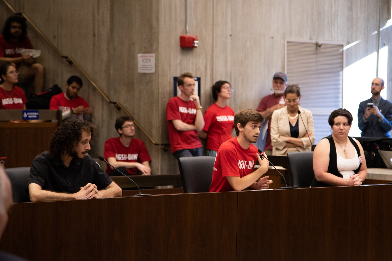 Members of the Harvard Graduate Students Union–United Automobile Workers testified at a Boston City Council hearing Thursday.