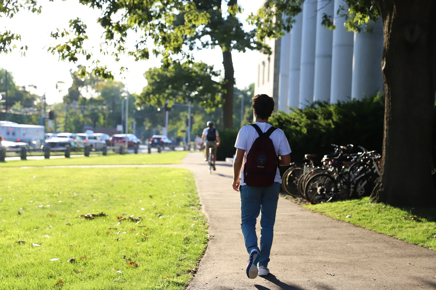 As the sun sat low in the sky, a student walked to shop a class in Littauer Hall Tuesday evening.