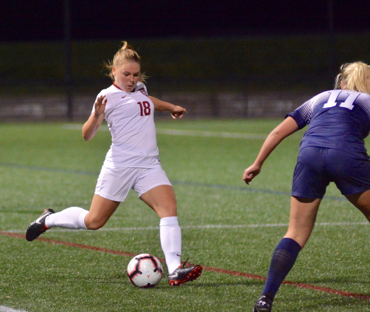 Sophomore defender Lara Schenk looks to find a teammate as she is pursued by an opposing striker. The Seelze, Germany native helped Harvard to its first clean sheet of the season as it cruised past Quinnipiac 3-0 on Wednesday.