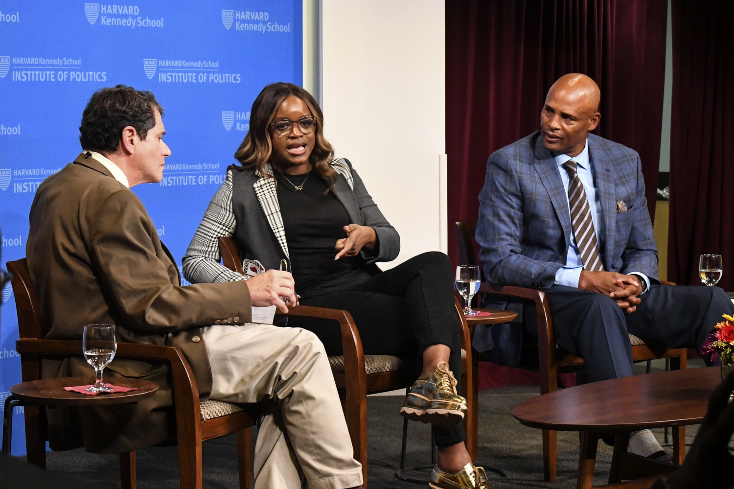 Former IOP fellow Brittany Packett, and former NBA player Clark Kellogg discuss the power of sports and the positive influence athletes can have on their community at an Institute of Politics event Tuesday night.