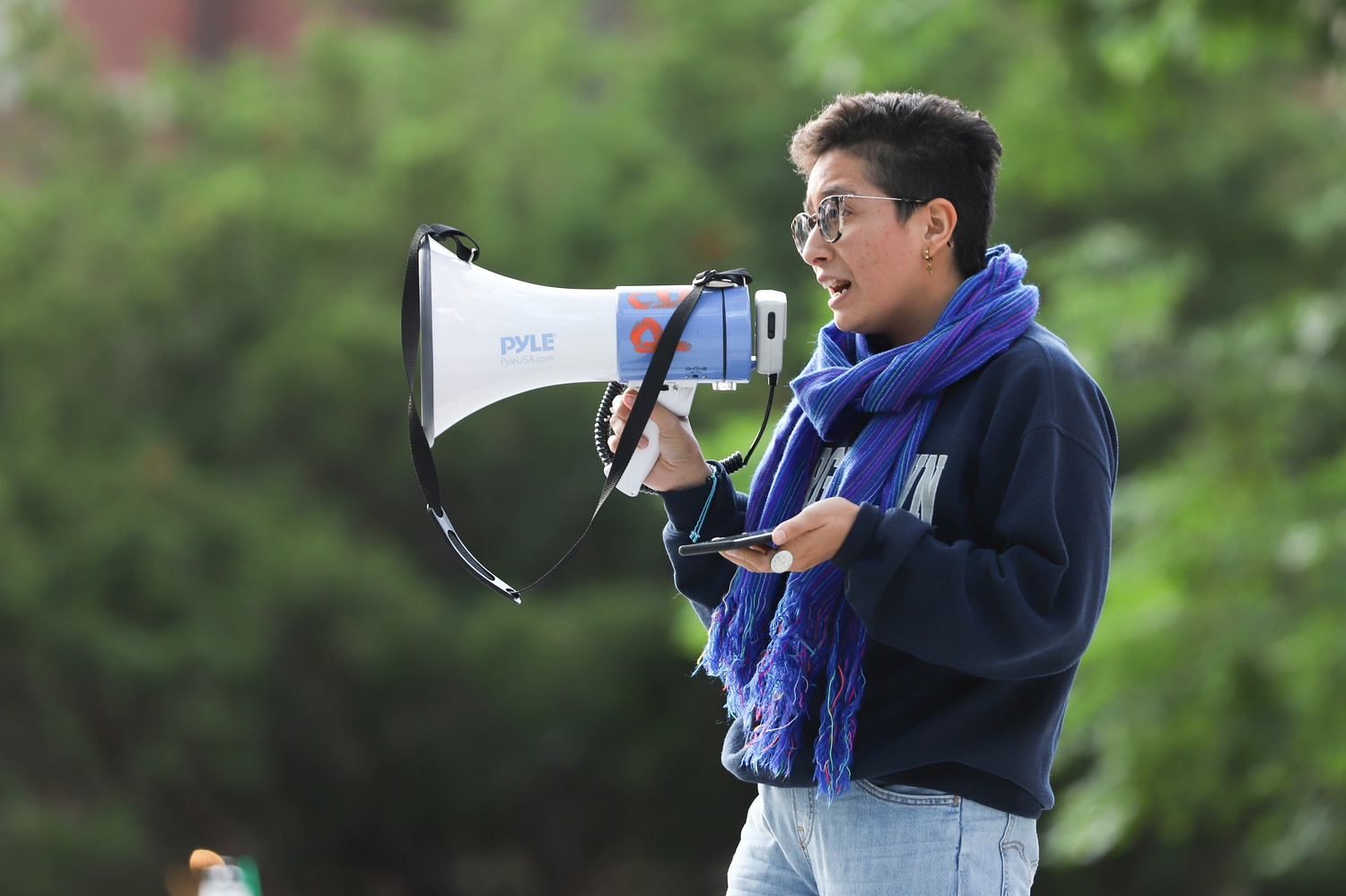 Ph.D. student Xitlalli Alvarez spoke in favor of divesting from private prisons at the rally Thursday.