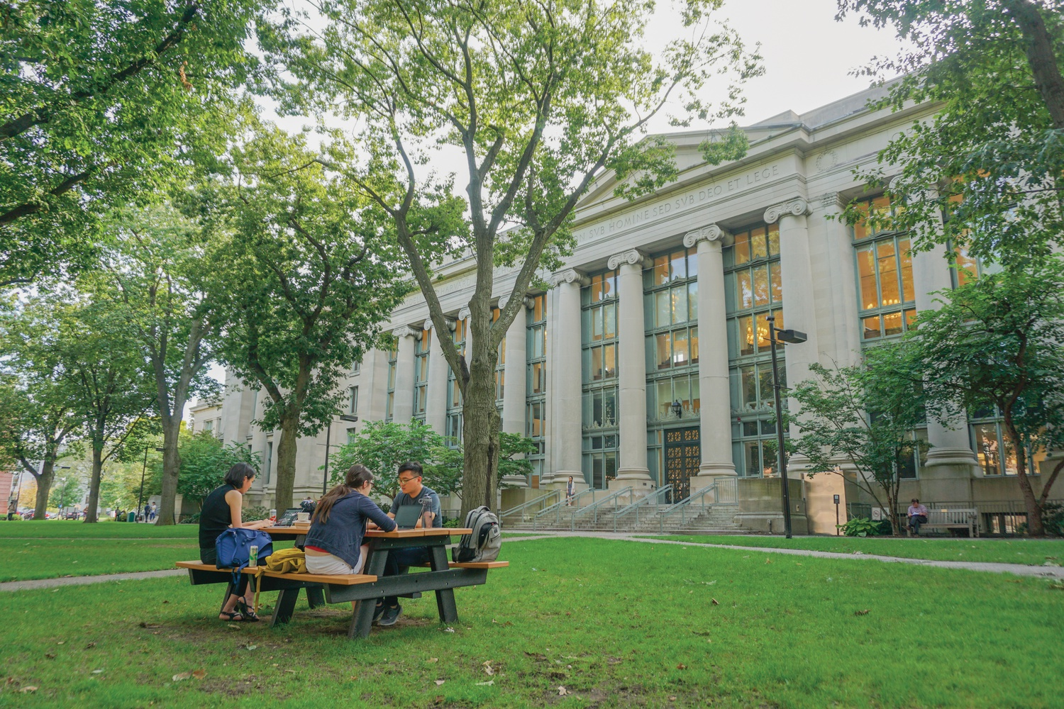Students eat lunch outside of the Harvard Law School Library. The Harvard Law School Class of 2022 is 50 percent women and 45 percent people of color.
