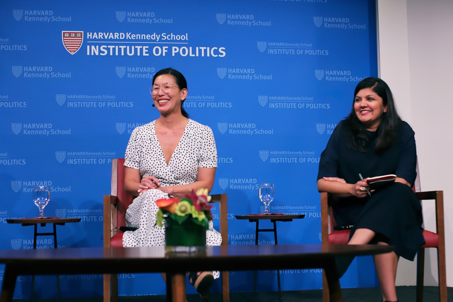 """Brittany Butler, the executive director of the Social Innovation and Change Initiative at the Harvard Kennedy School moderated a discussion between Ai-Jen Poo, left, the co-founder and executive director of the National Domestic Workers Alliance, and Palak Shah, right, the founding director and social innovation lab director at NDWA. Poo and Shah discussed domestic work as the original """"gig economy"""" and talked about the importance of intersectionality."""