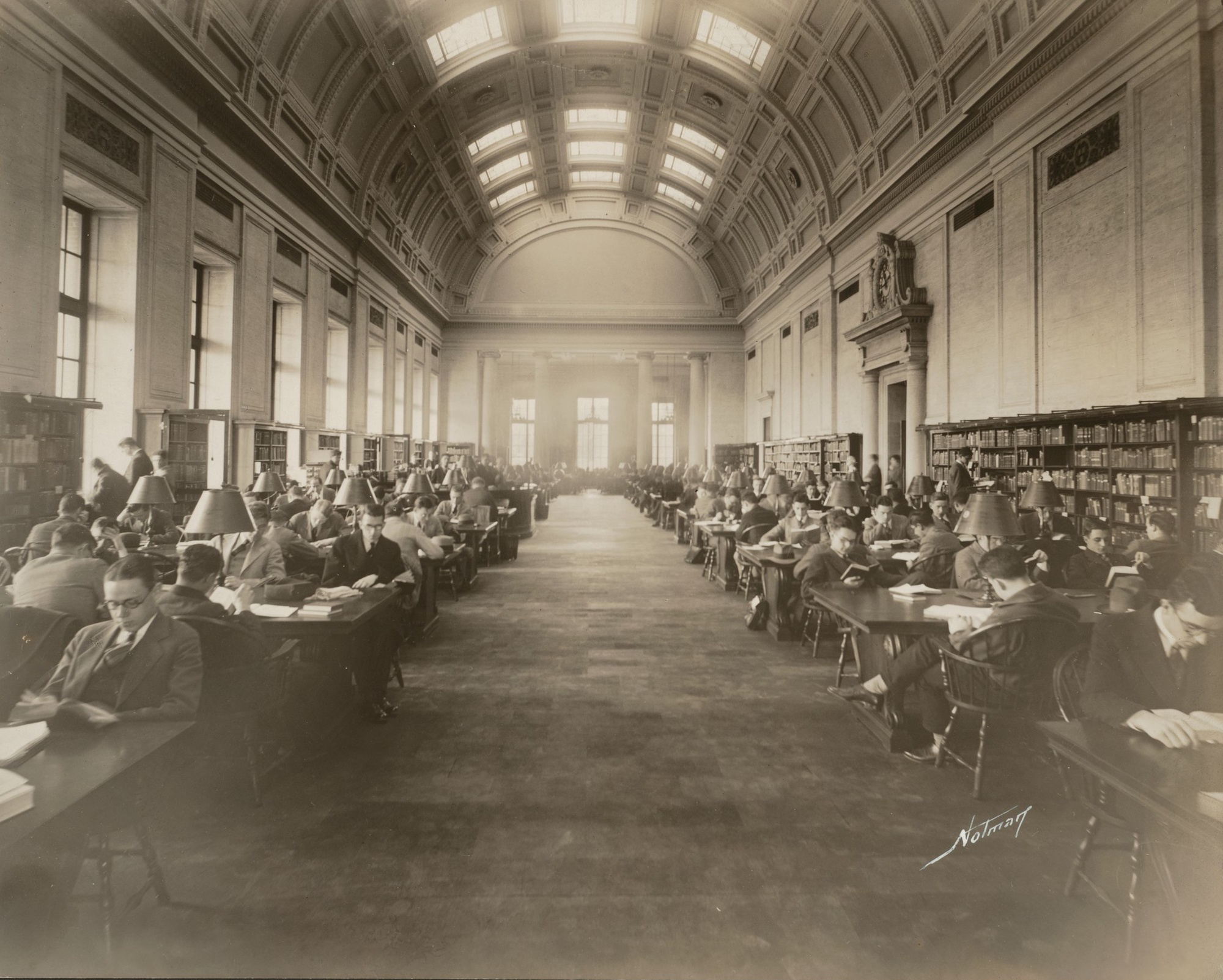 Harvard students study in the Widener Library Reading Room at the beginning of reading period in June 1927.