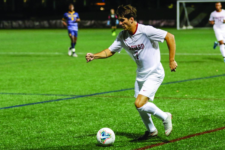 Nico Garcia-Morillo dribbling down the field against Merrimack
