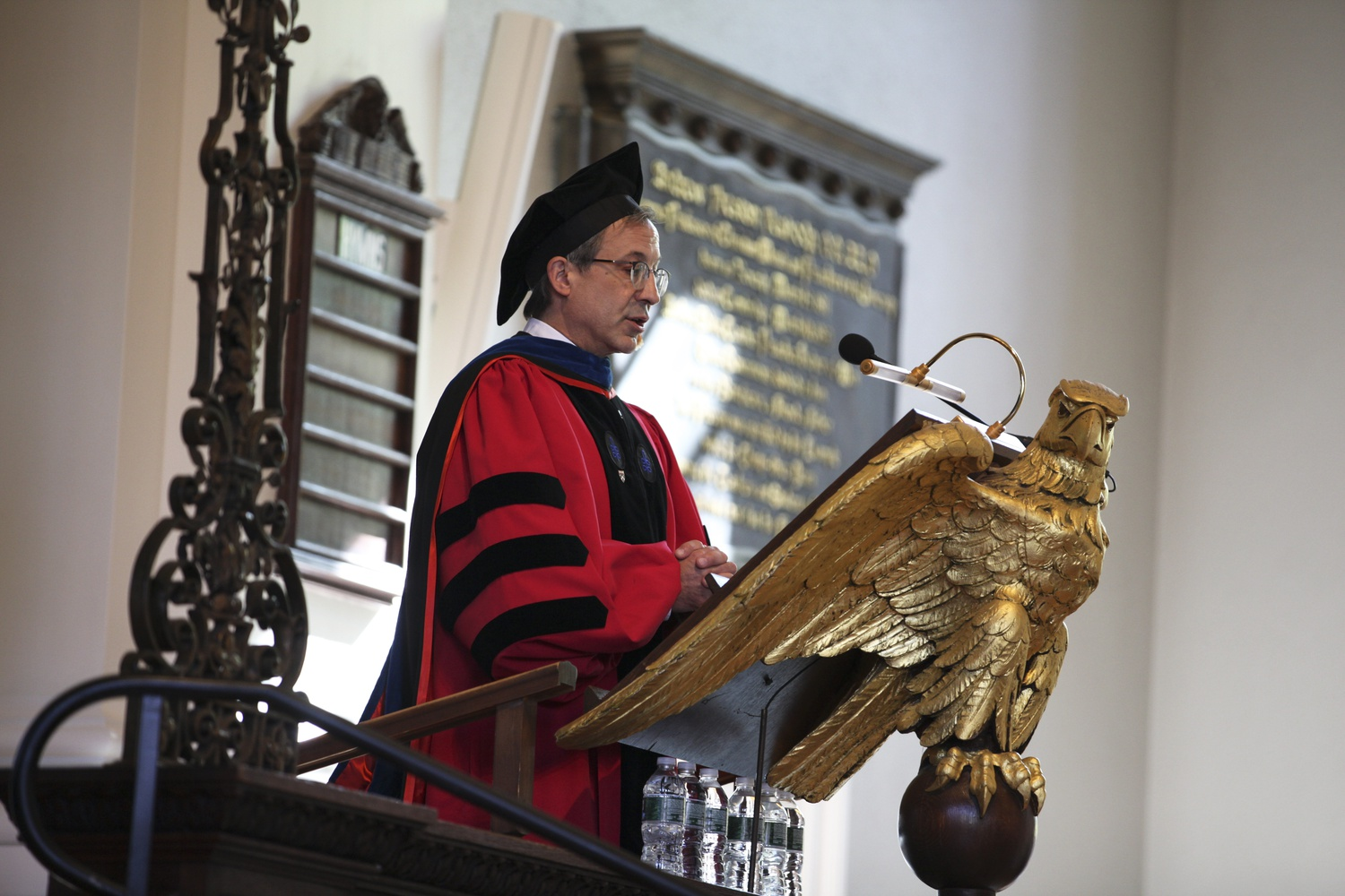 """Dean of Students and Accessibility Robert H. Neugeboren '83 assures students that they """"belong here"""" during Harvard Extension School's Convocation held at Memorial Church Saturday afternoon."""