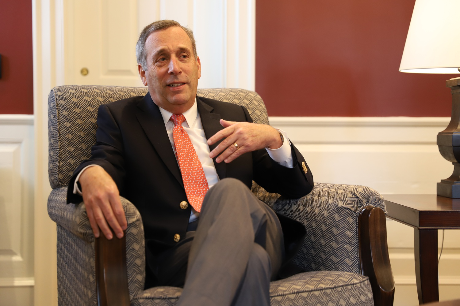 University President Lawrence S. Bacow speaks with a colleague in his office in Massachusetts Hall before an October interview with The Crimson.