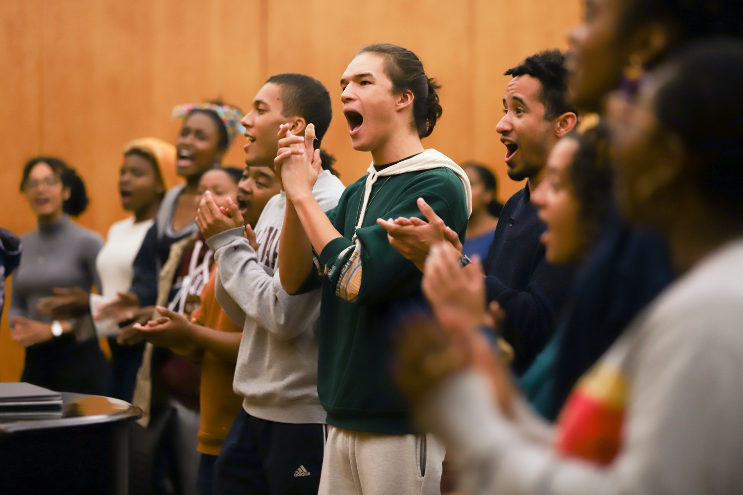 The Kuumba Singers of Harvard College clap and sing during a weekly rehearsal. Founded in 1970, Kuumba, the oldest existing Black organization at Harvard College, will celebrate its 50th anniversary this year.