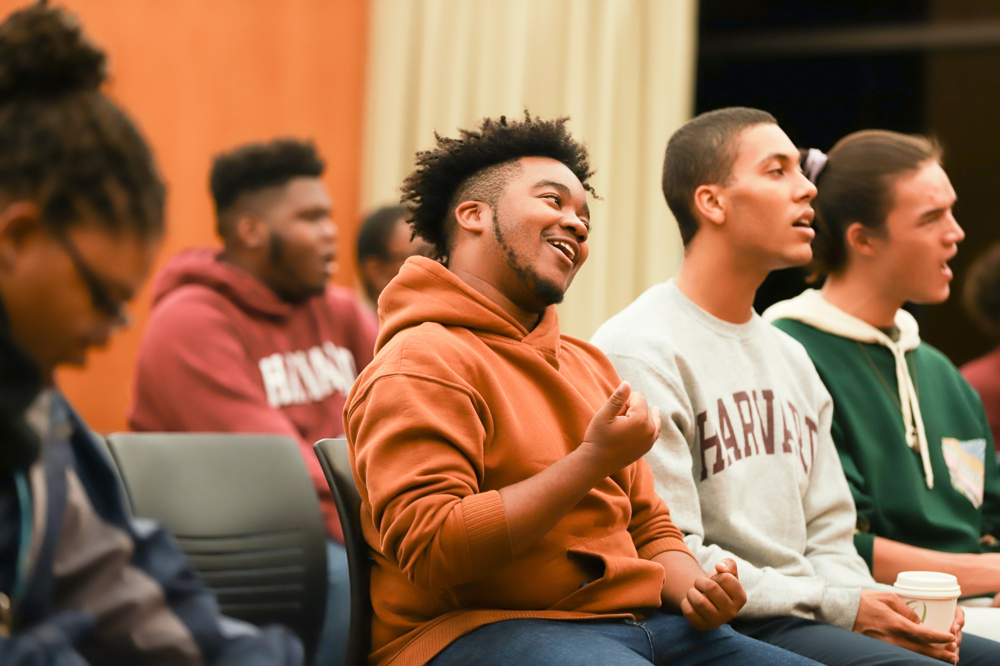 Harvard Law School student Jason Colin sings and dances during a Kuumba Singers of Harvard College rehearsal.