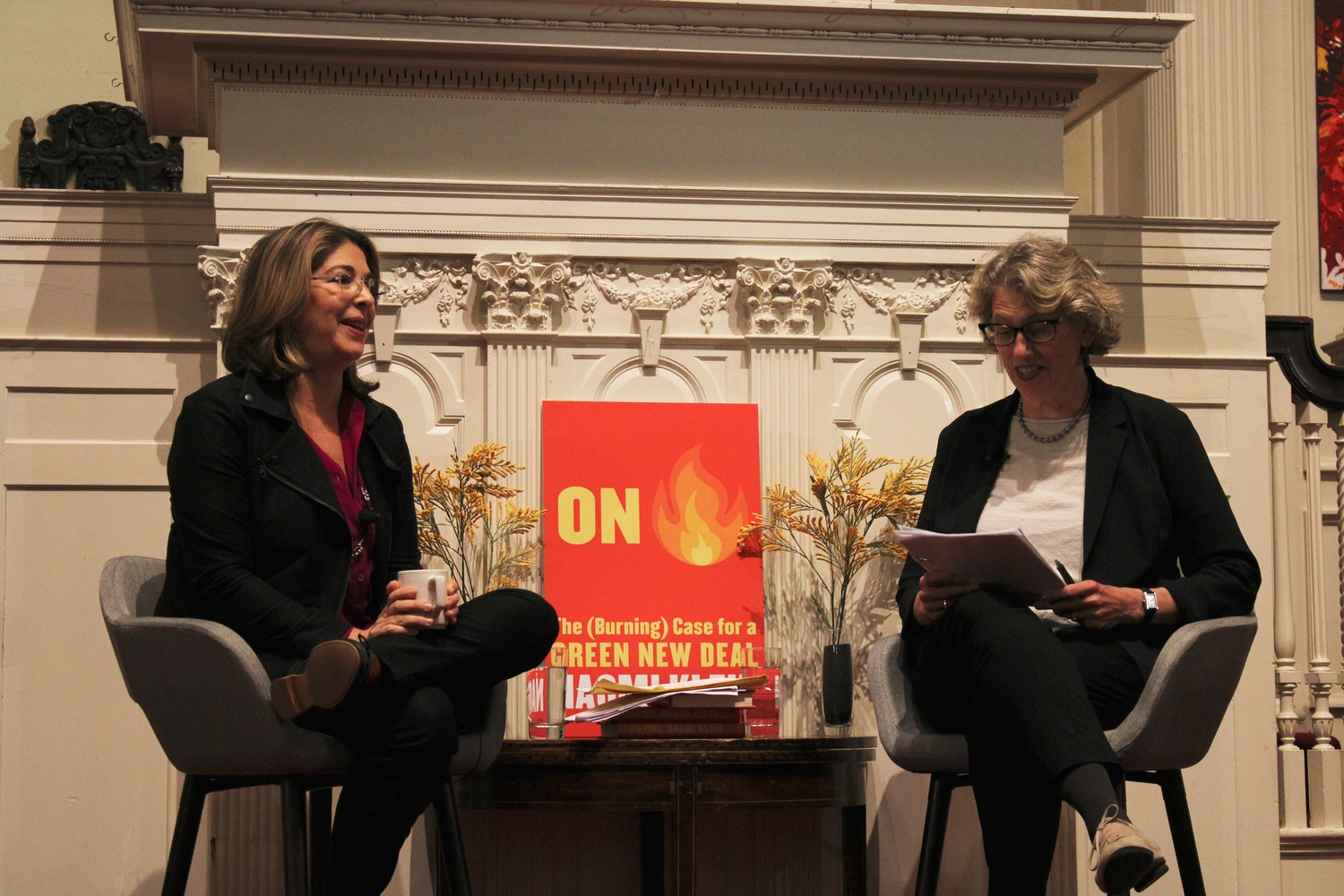 """Author Naomi Klein (left) discusses her new book """"On Fire"""" with Boston College professor Juliet B. Schor at an event at the First Parish Church Thursday evening."""