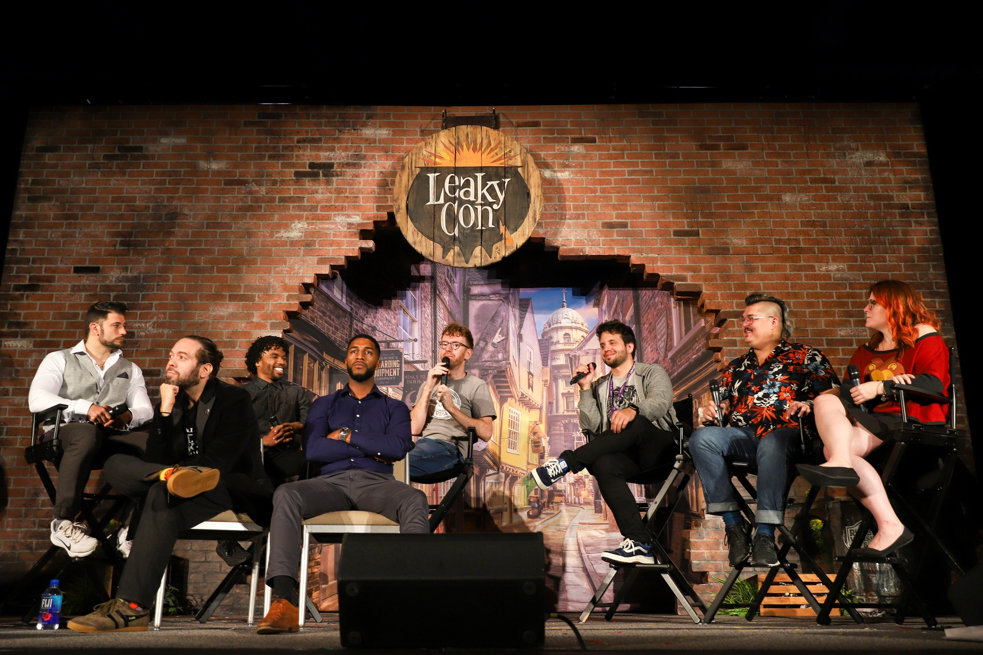 "Stanislav Yanevski (""Victor Krum""), Dan Fogler (""Jacob Kowalski""), Luke Youngblood (""Lee Jordan""), Louis Cordite (""Blaise Zabini""), and Chris Rankin (""Percy Weasley"") sit on a panel reminiscing fondly about behind the scenes shenangians of the Harry Potter film series."