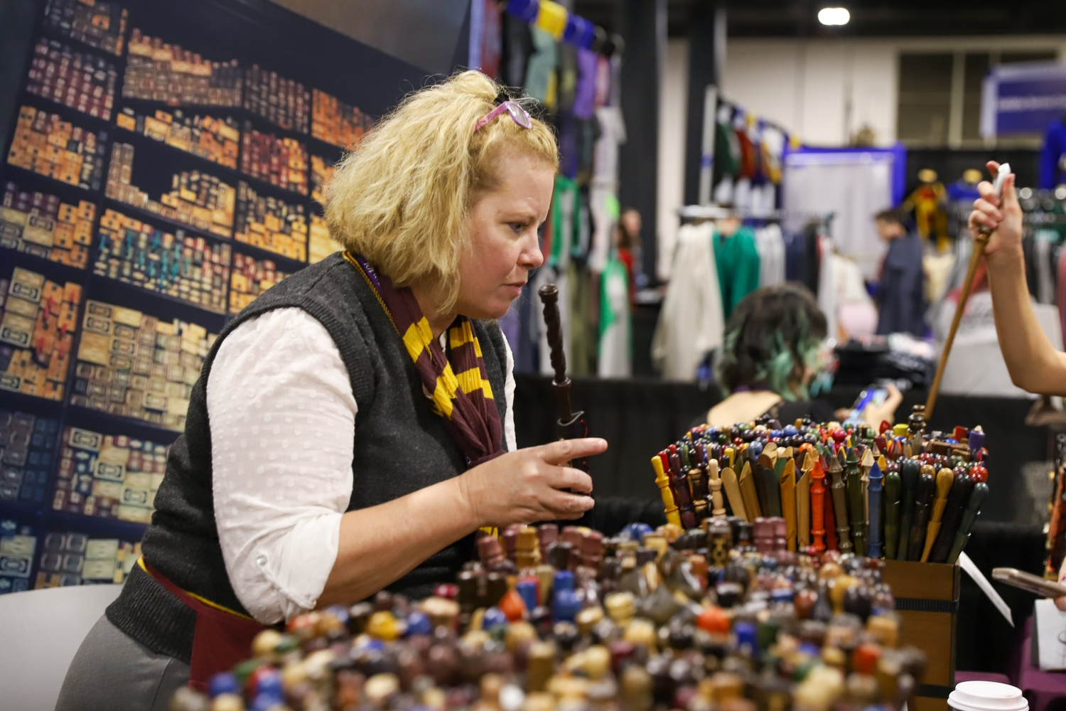 Lisa B. Laslo and her husband Greg E. Laslo opened the Hungarian Wand Shop after he carved a wand for his nephew. Their endeavour has taken them around the world selling hand-carved wands, currently attending their 9th LeakyCon.