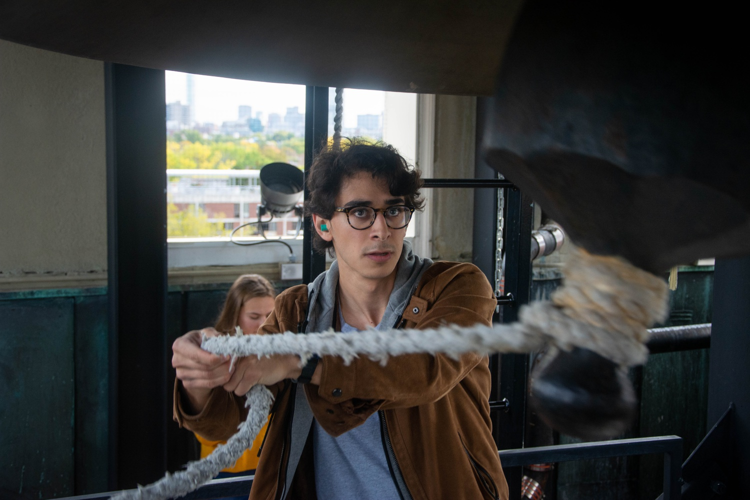 """Alejandro Lampell '20 rings the bell """"Mother Earth"""" in Lowell House Sunday at 1 p.m."""