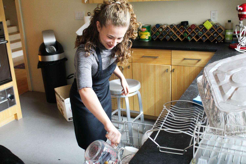 "Pforzheimer ""House Elf"" Jennifer A. Kunes '19 prepares to cook in the Faculty Dean's kitchen."