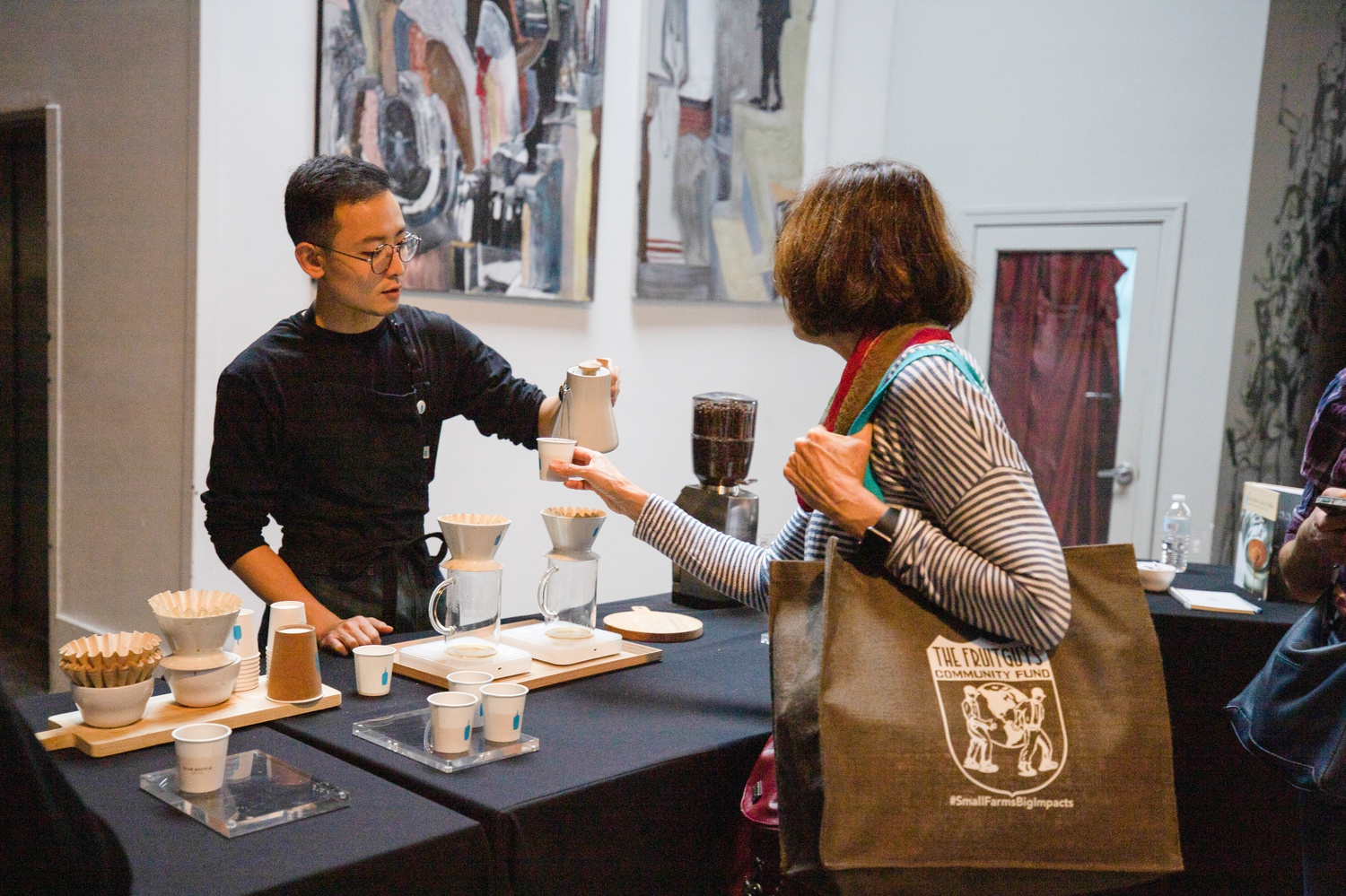 A Blue Bottle Coffee employee serves free samples at the New England Chocolate Festival.