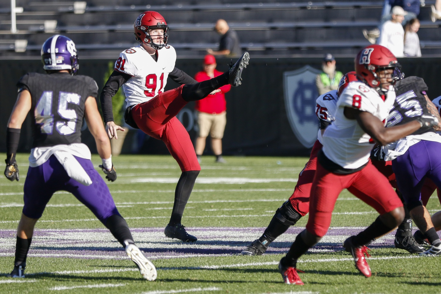 Harvard punter Sean McKeogh sends a the ball back to Holy Cross. The senior punted six time, five of which landed within the opponents 20-yard line.