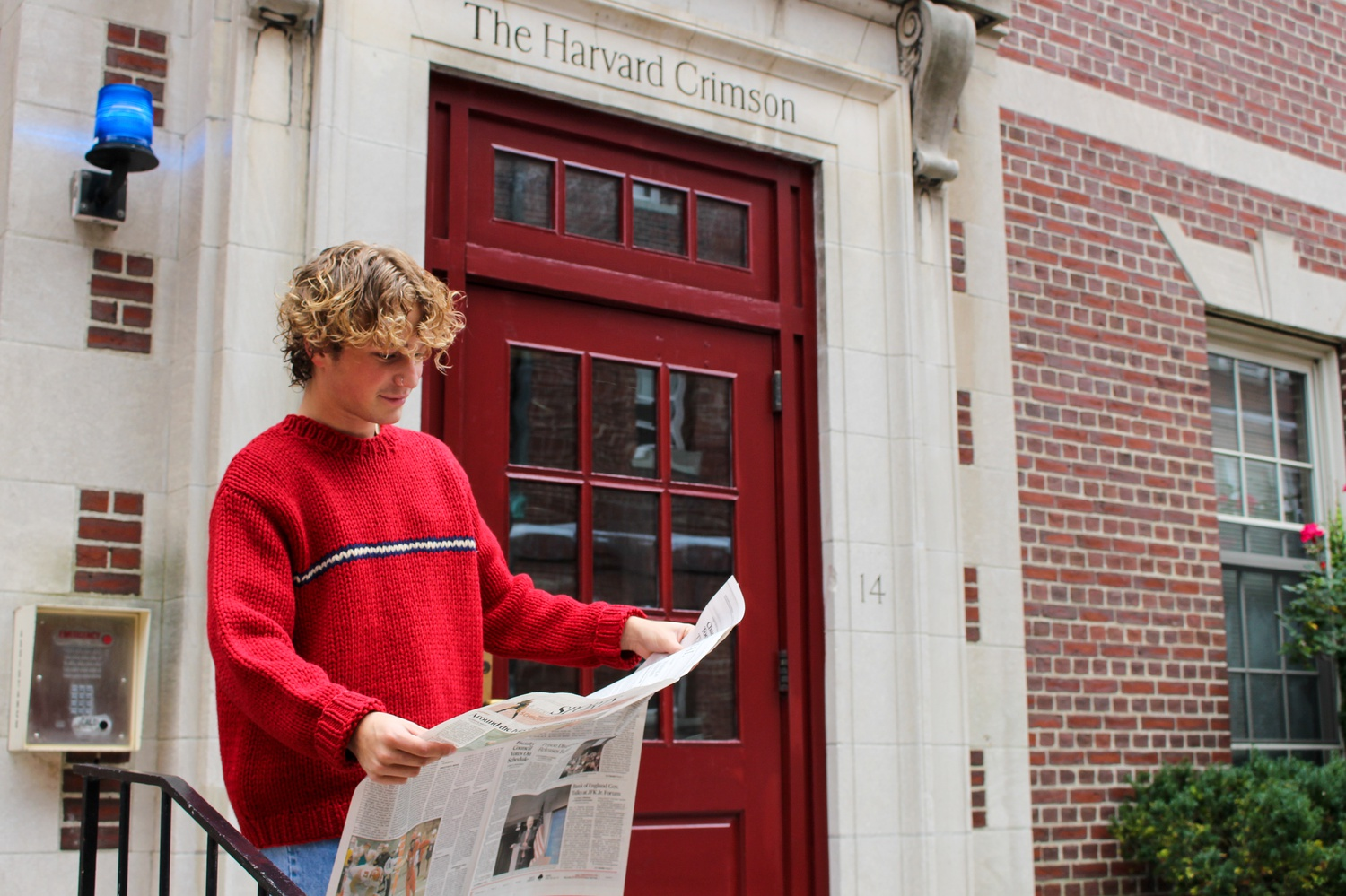 Paul G. Sullivan reads an edition of the Harvard Crimson's newspaper, the daily that Pete Buttigieg wrote a regular column for during his years as a student.