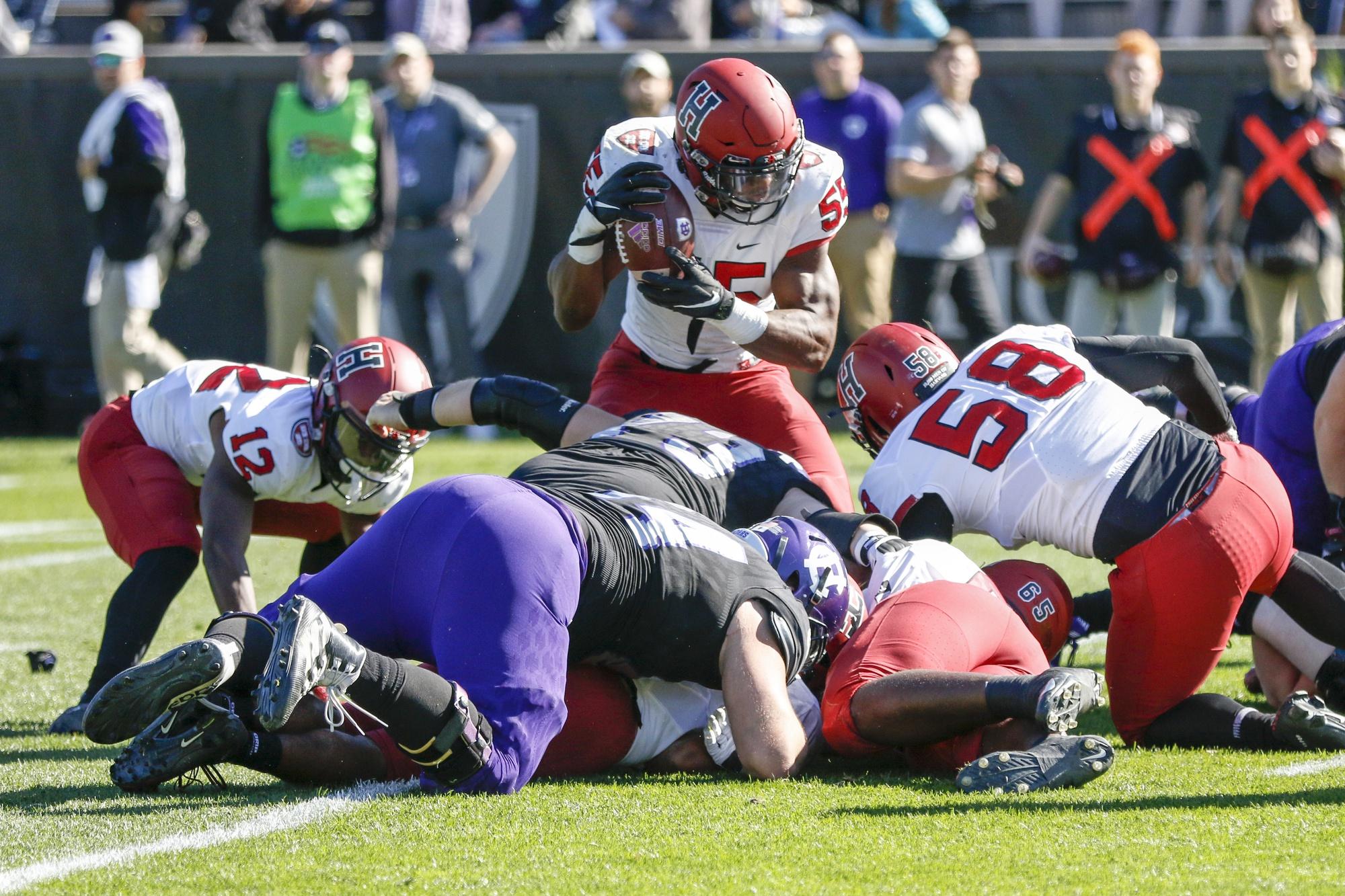 Junior linebacker Jordan Hill recovers a fumble in Saturday's contest. The junior is averaging 4.2 tackles per game.