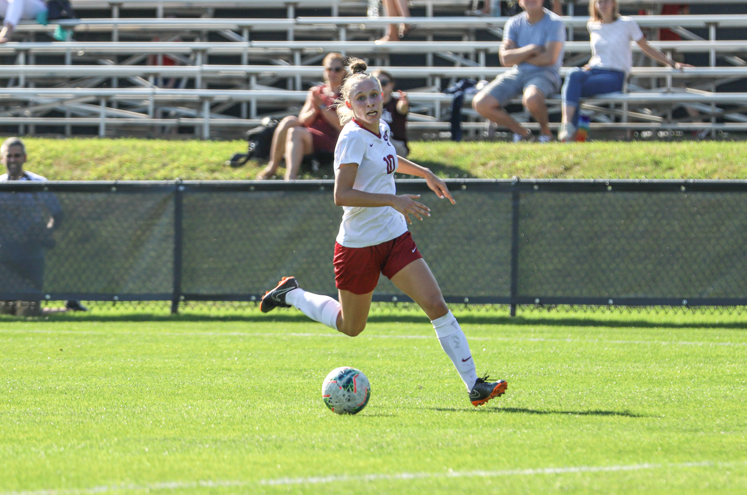 Freshman Angela Caloia approaches the net for the Crimson. The first-year was one of two players who scored in the team's loss to Brown Saturday.