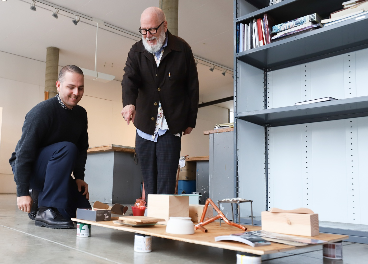 """Professor and artist Stephen J. Prina and teaching fellow Hadi Fallahpisheh observe a student project for their class Art, Film, and Visual Studies 80: """"Loitering: Studio Course."""""""