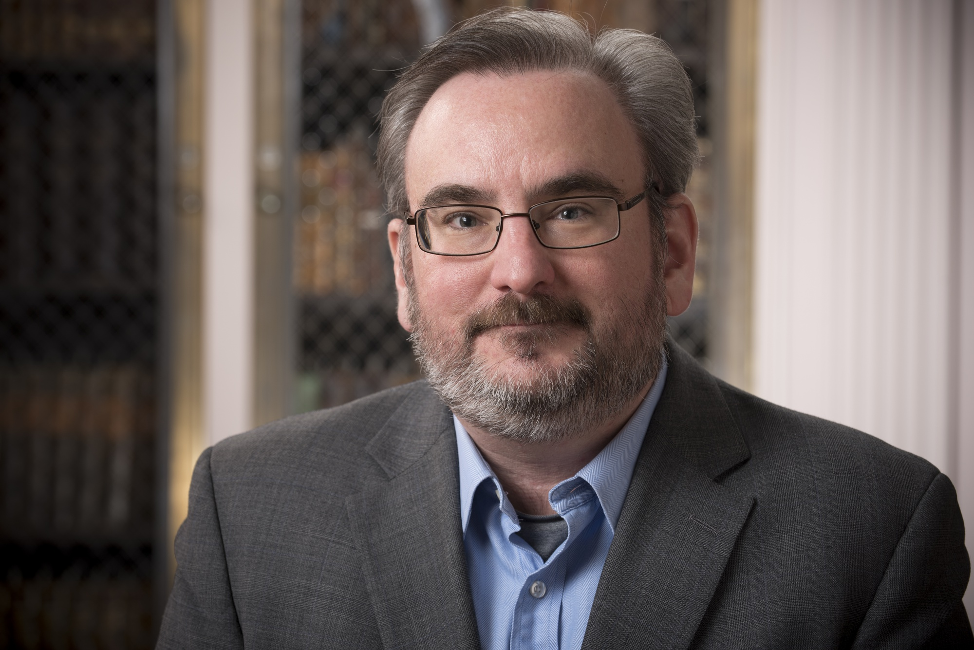 John H. Overholt, a curator at Houghton Library and avid tweeter @john_overholt, hopes to display diverse collection of books and build a welcoming atmosphere.