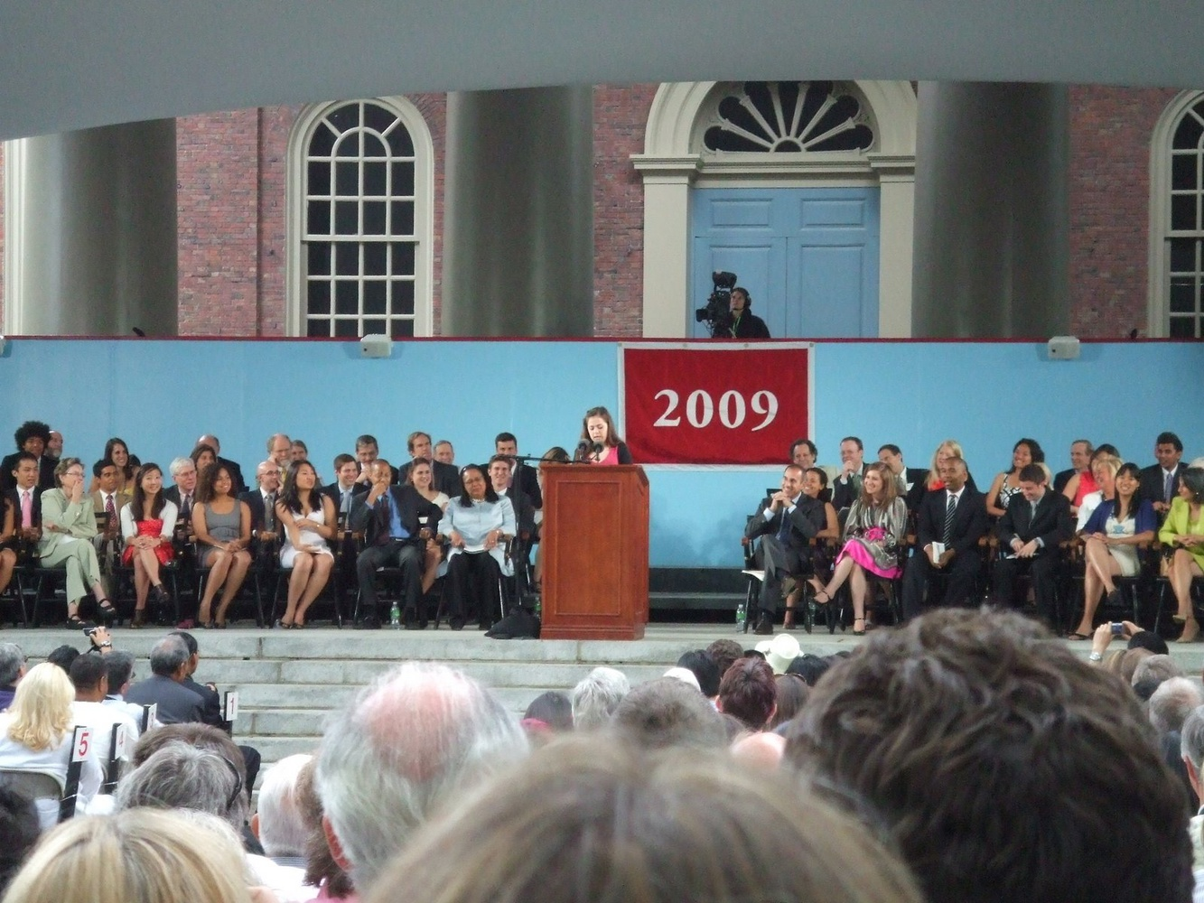 Seniors watch a student speaker during the Commencement Day exercises in June 2009.