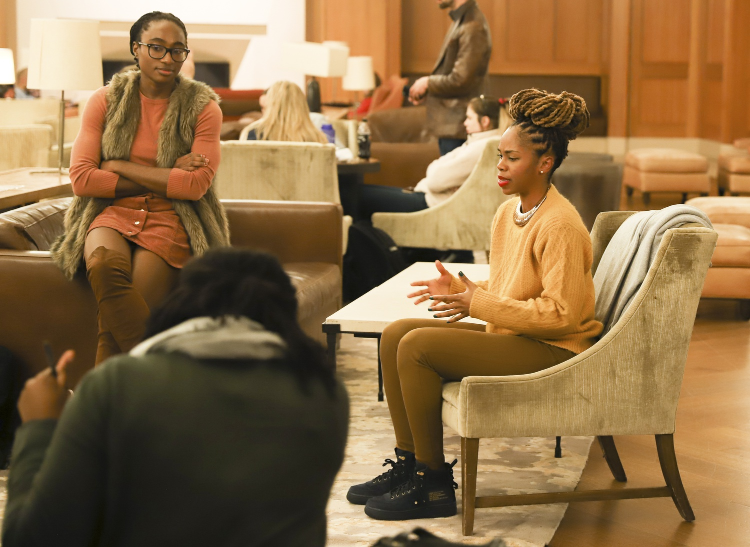 Law School alum Derecka Purnell and organizers for the Harvard Prison Divestment Campaign discuss prison abolition at an event Thursday evening.