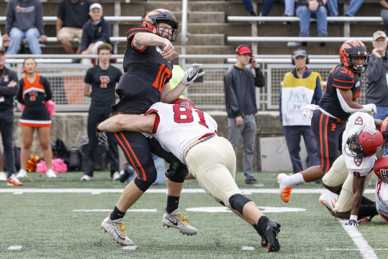 Quarterback Kevin Davidson gets a pass off just before being sacked by Crimson senior defensive lineman Brogan McPartland.