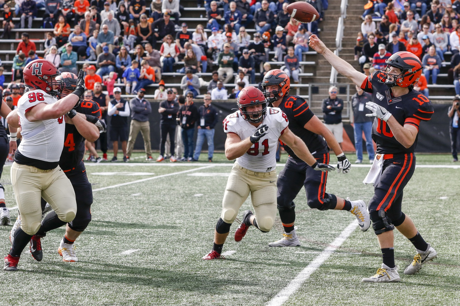 Harvard tight end Haven Montefalco just misses sacking Princeton quarterback Kevin Davidson, who went on to complete three touchdowns in the Tigers' victory.