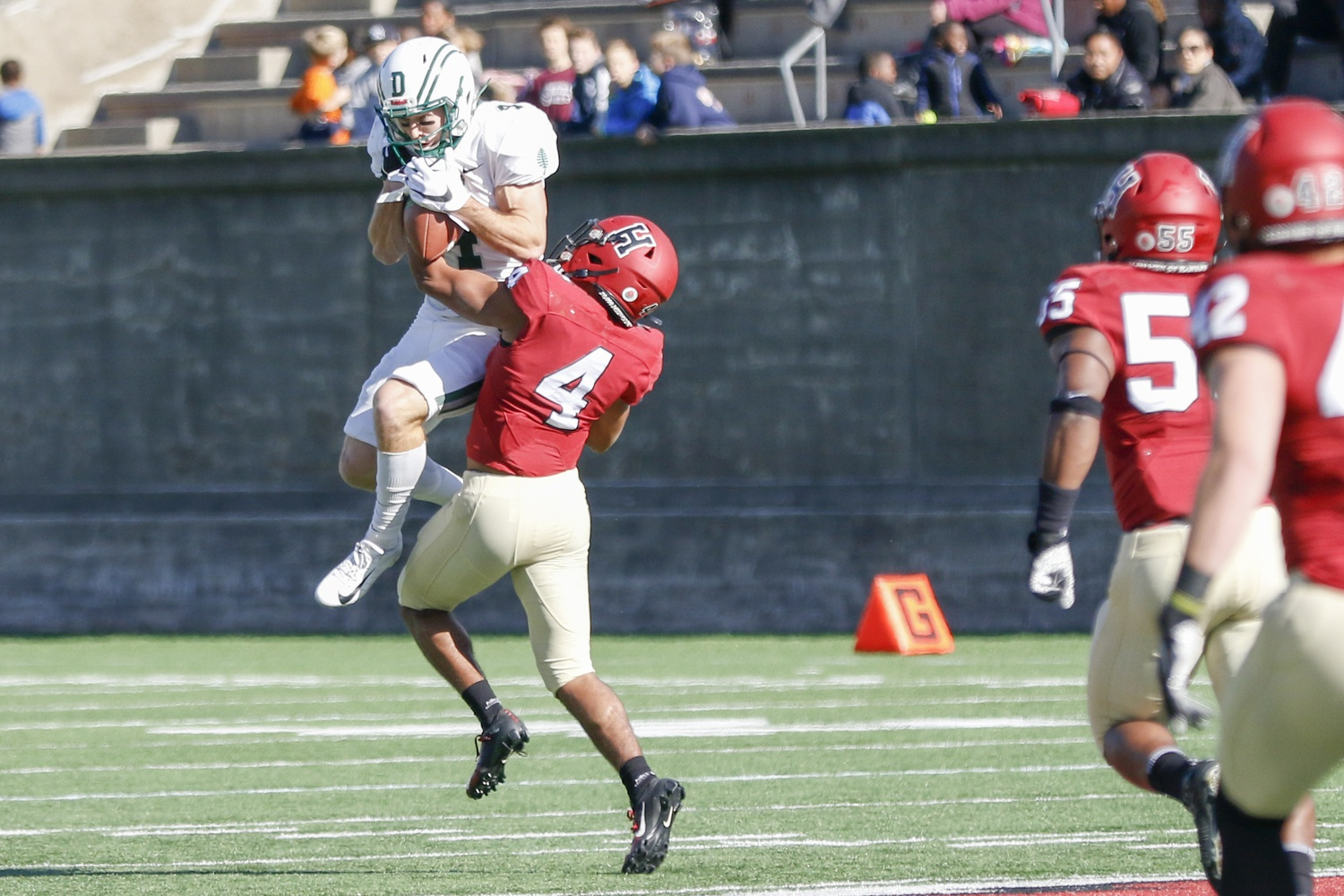 Big Green wide out Drew Estrada, makes a grab at a deep pass, only to be stripped by Harvard's Max Jones as he falls to the ground. The change of possession, listed as an interception, is Jones' first of the season.