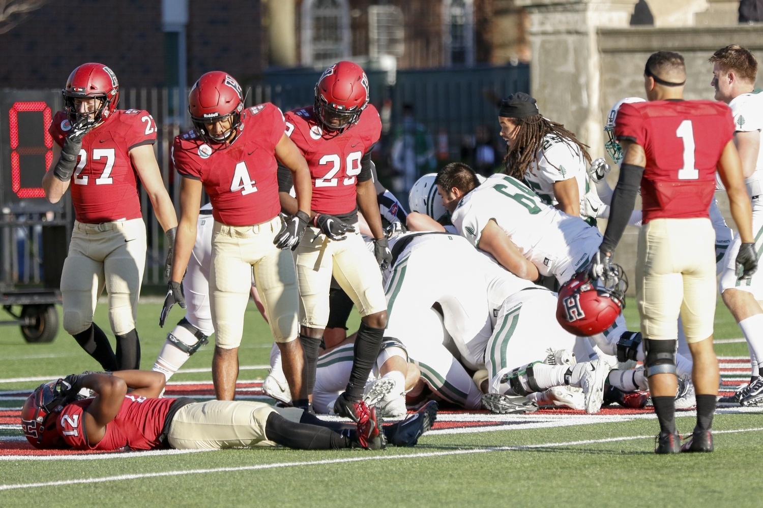 Junior defensive back Isaiah Wingfield lays on the ground after Dartmouth's, final second, Hail Mary attempt is successful. The loss ends Harvard's chances at an Ivy League title.