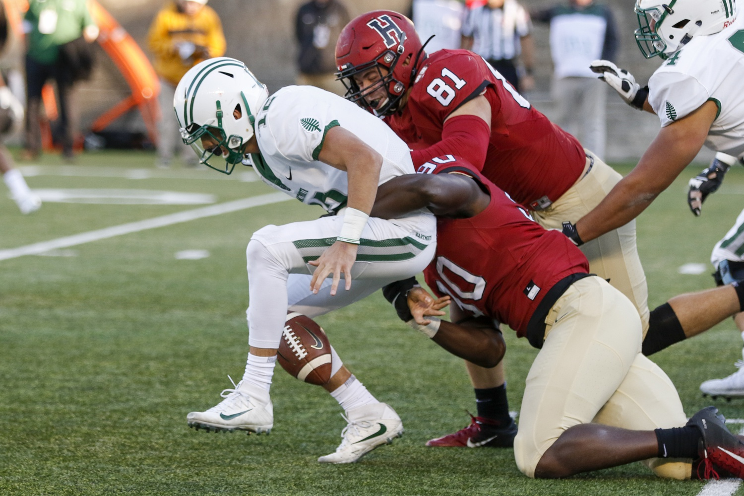 Sophomore defensive lineman Truman Jones strips Dartmouth quarterback Derek Kyler. The change of possession returned the ball to Harvard with the lead and 1:19 to burn.
