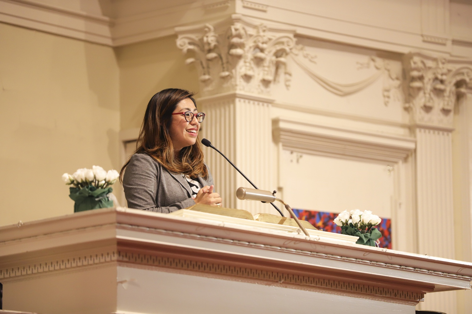 """Cristina Jiménez speaks during the Robert Coles """"Call of Service"""" Lecture Friday evening at the First Parish Unitarian Universalist Church."""
