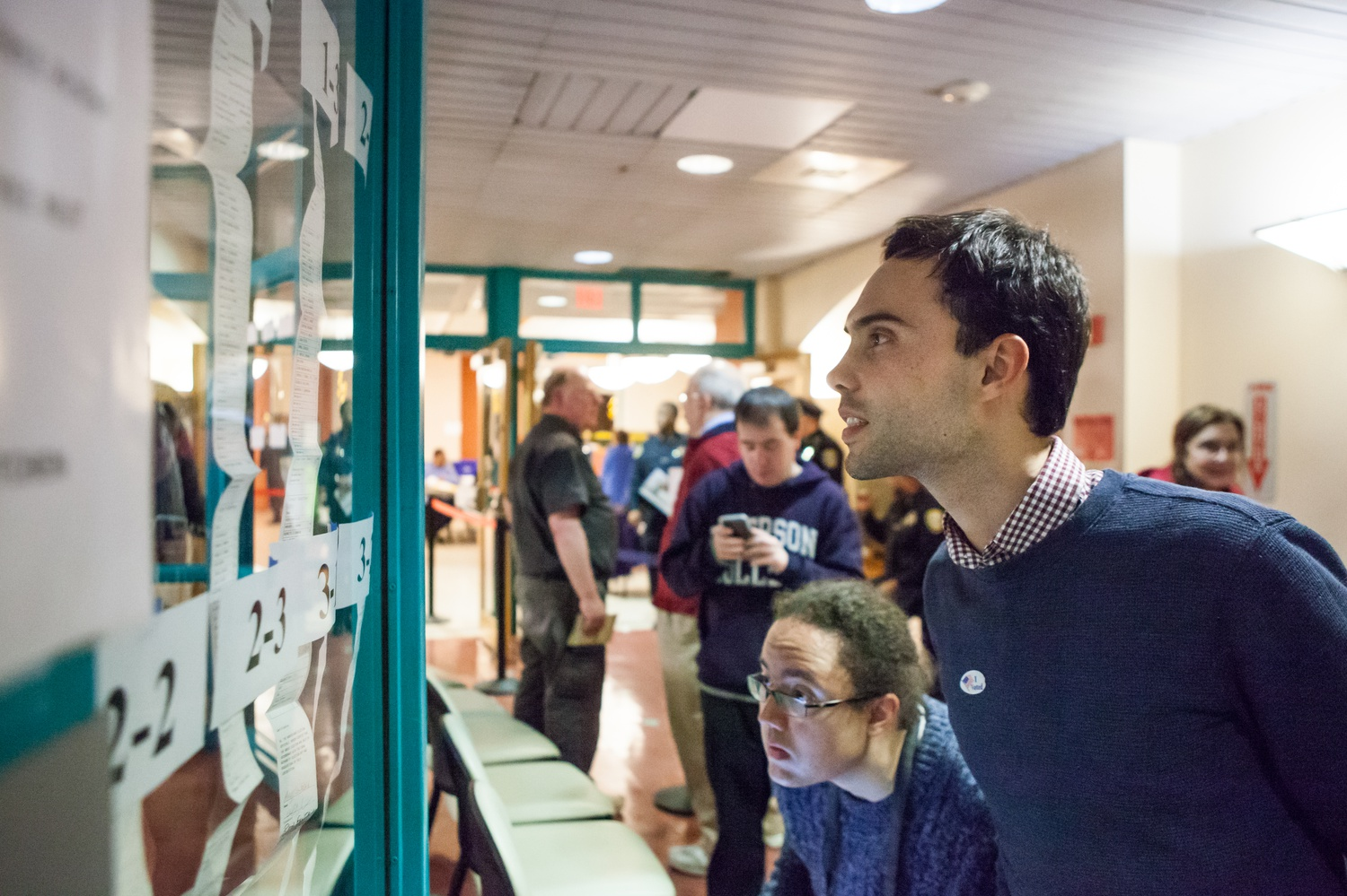 Patrick C. Braga, a student at the Graduate School of Design, checks the results for each precinct. As precincts reported to the Election Commission, the top candidates were posted in the hallway of the Cambridge Citywide Senior Center.