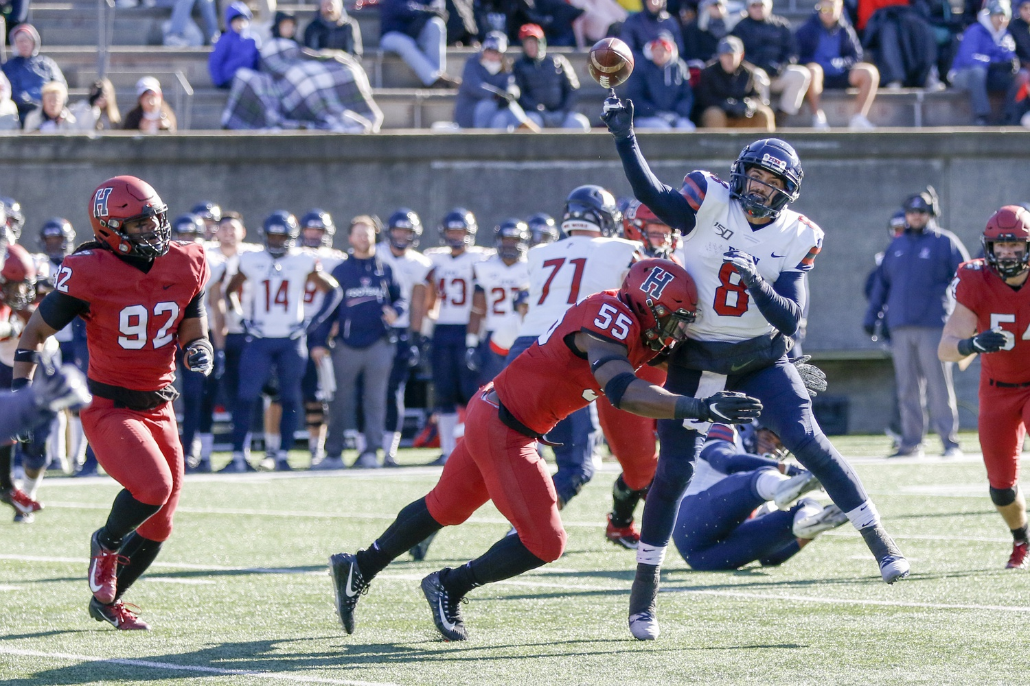Junior linebacker Jordan Hill hits Penn quarterback Nick Robinson as he throws. The visiting play caller was bullied all afternoon, thrown to the ground as he threw on several occasions.