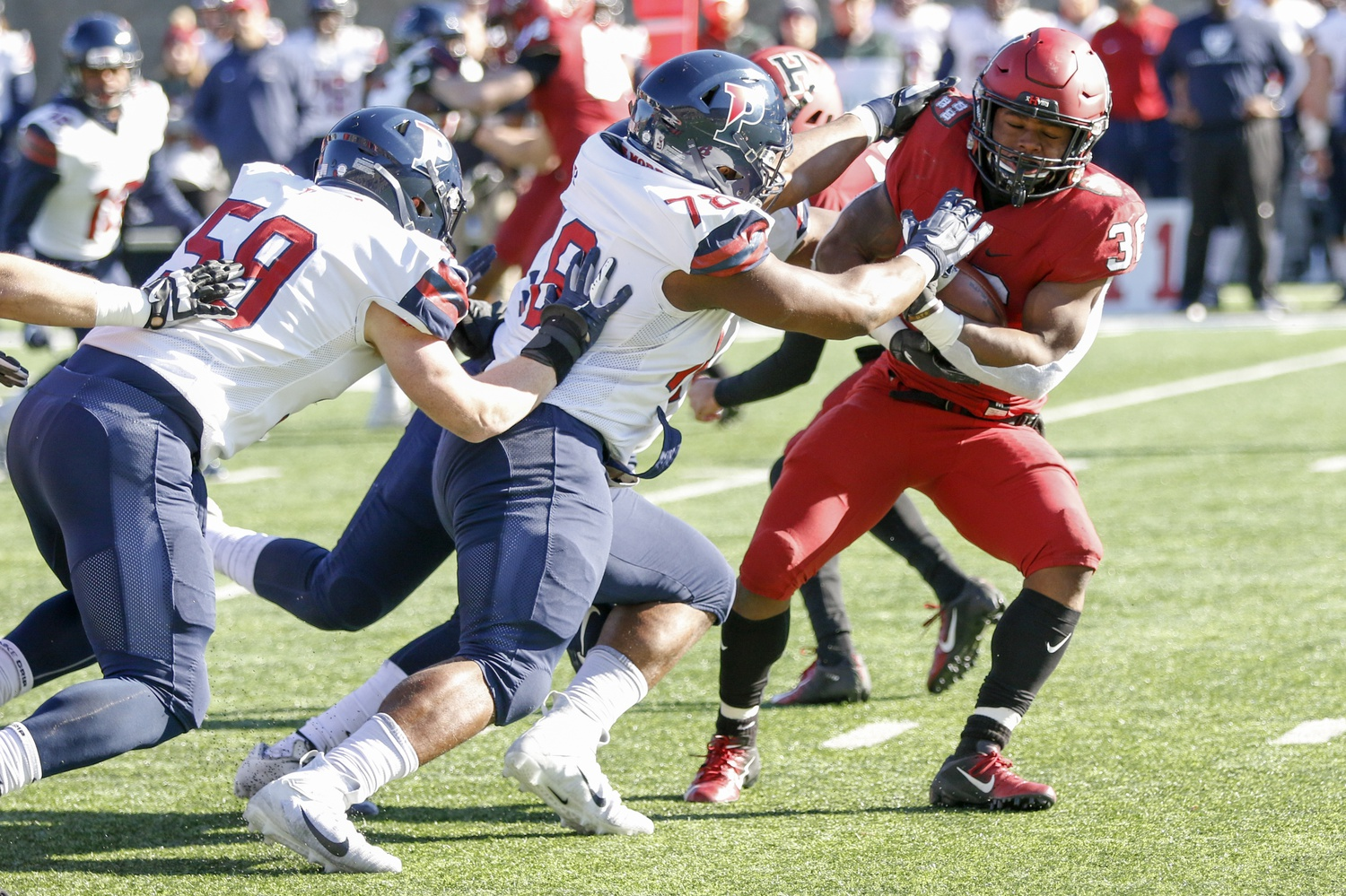 Running back Devin Darrington is swallowed up at the line of scrimmage on Saturday afternoon. The Crimson net only 62 rushing yards on the afternoon.