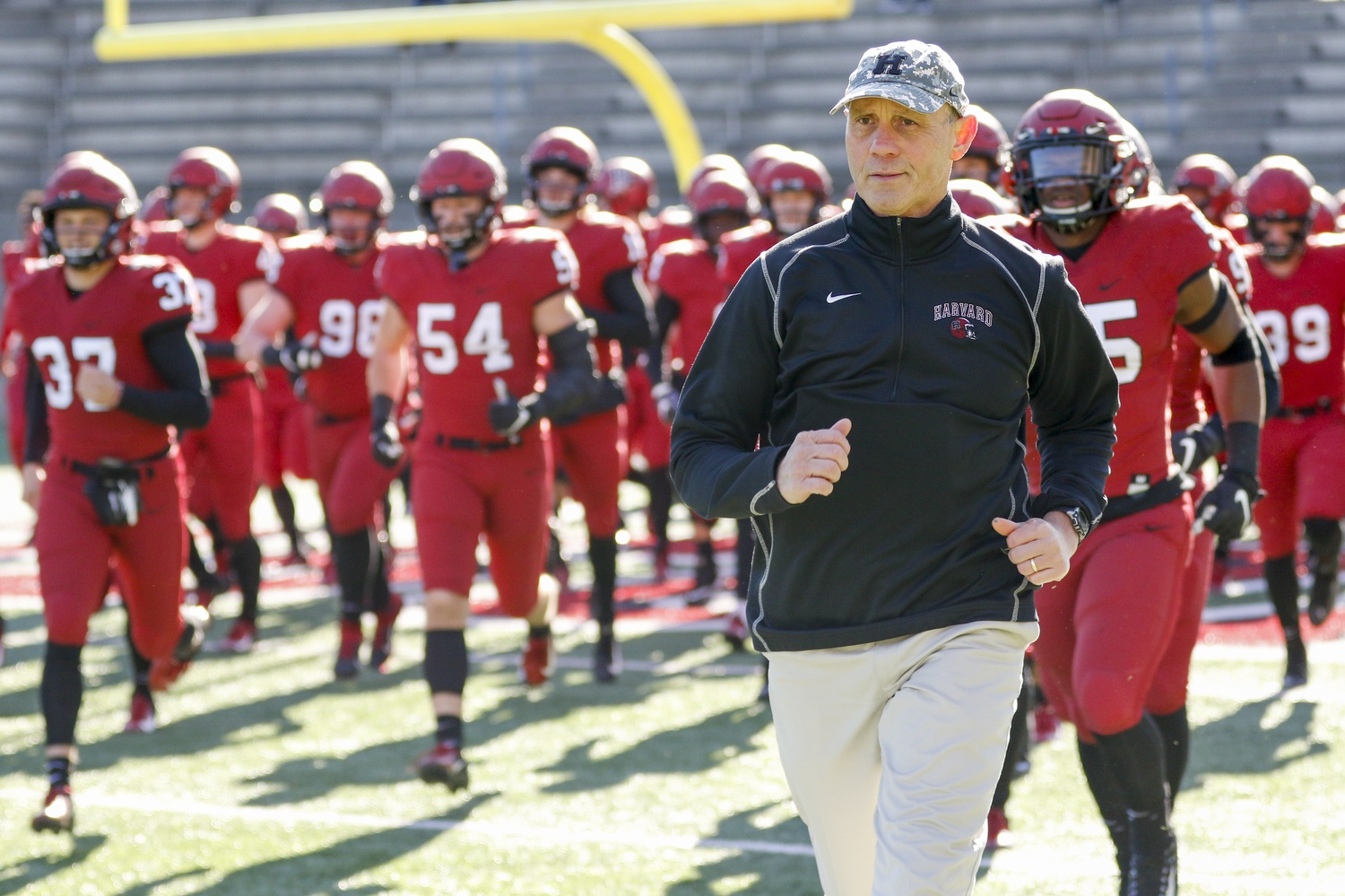 Coach Tim Murphy leads his players onto the field, an exercise he has now performed for the Crimson for 26 years.