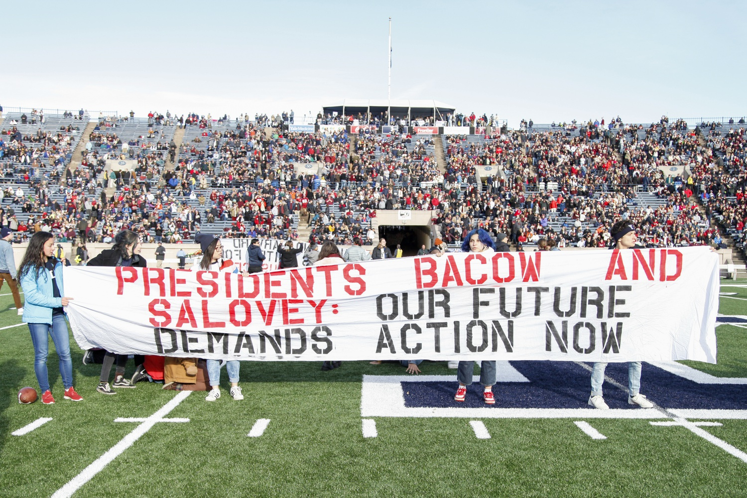 Students at Harvard and several other Ivy League institutions have long pushed for their universities divest from fossil fuels — including through a protest on the field of the Yale Bowl during halftime of the 136th edition of the Game.