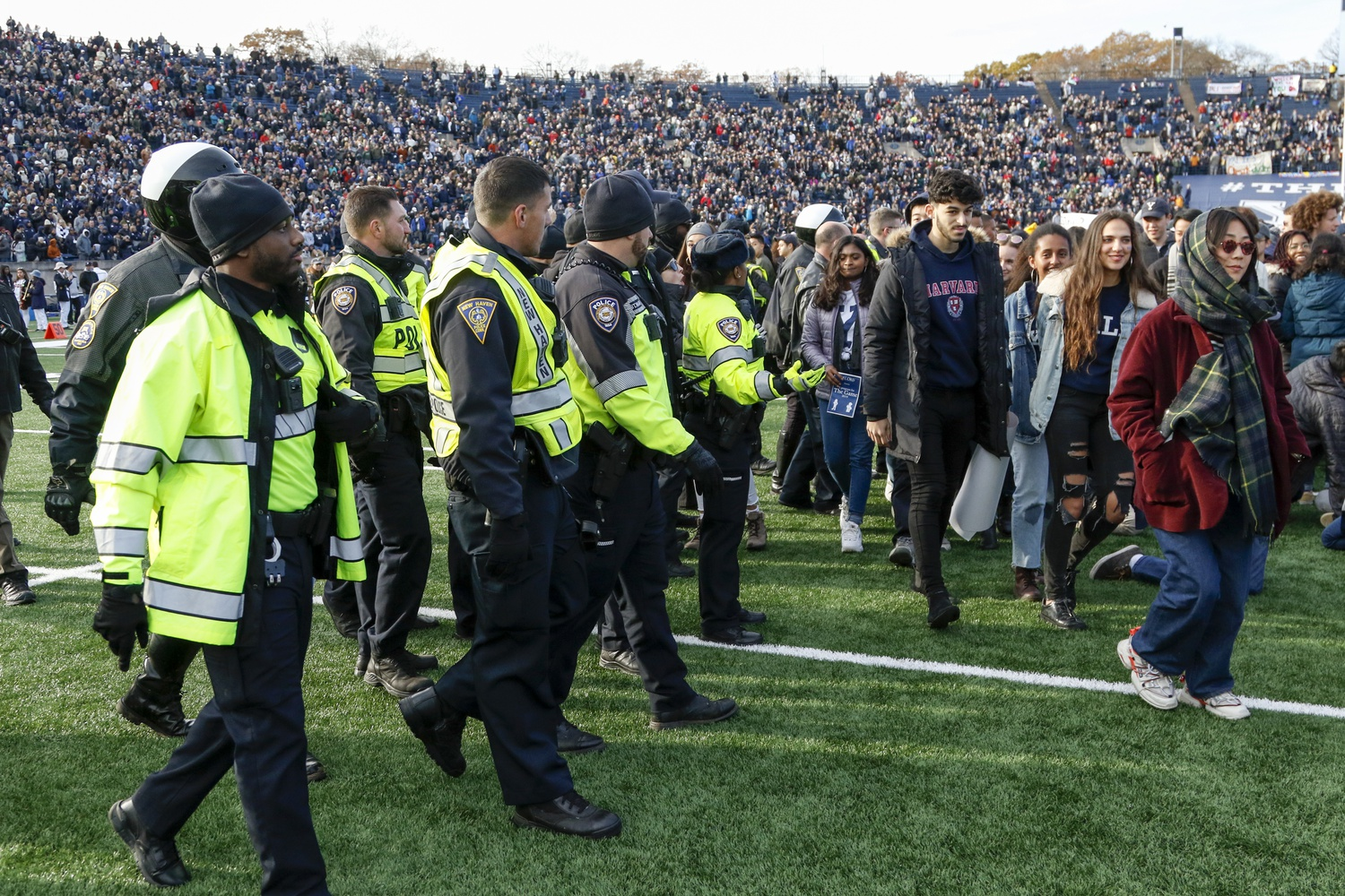 Dozens of police officers walked onto the field during The Game to urge protesters to leave.