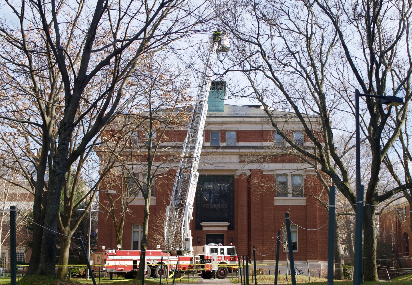 Cambridge firefighters douse the flames in Emerson Hall after smoke started pouring out of the building around noon on Friday.