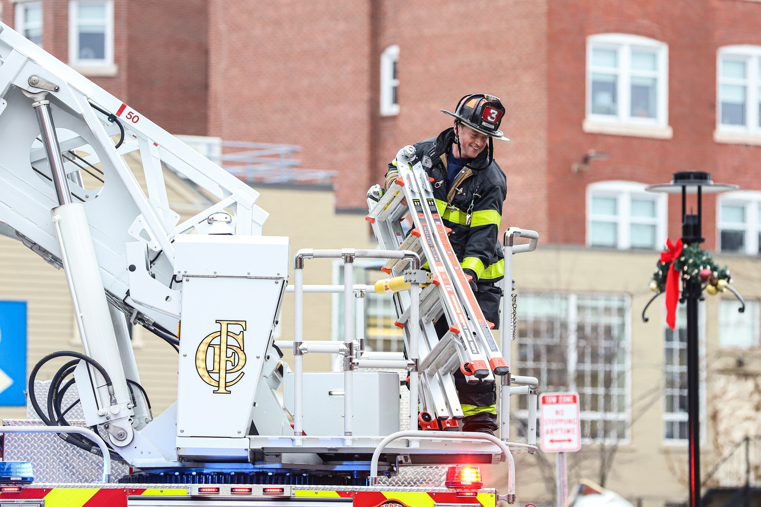 At least 40 firefighters were deployed to respond to a fire in the exhaust duct of the shared Border Cafe and Harvard Global Health Institute building at 32 Church St. Sunday afternoon.