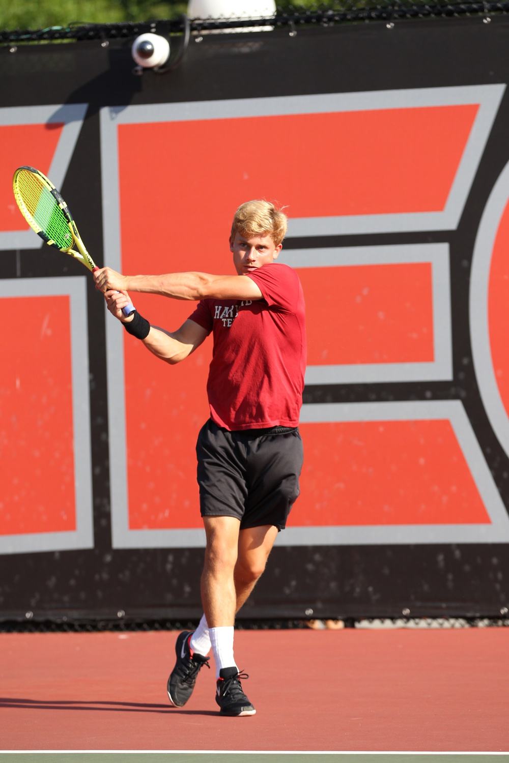 Junior Lane Leschly follows through on a backhand for Harvard Men's Tennis, a team he shares with his brother, Bo
