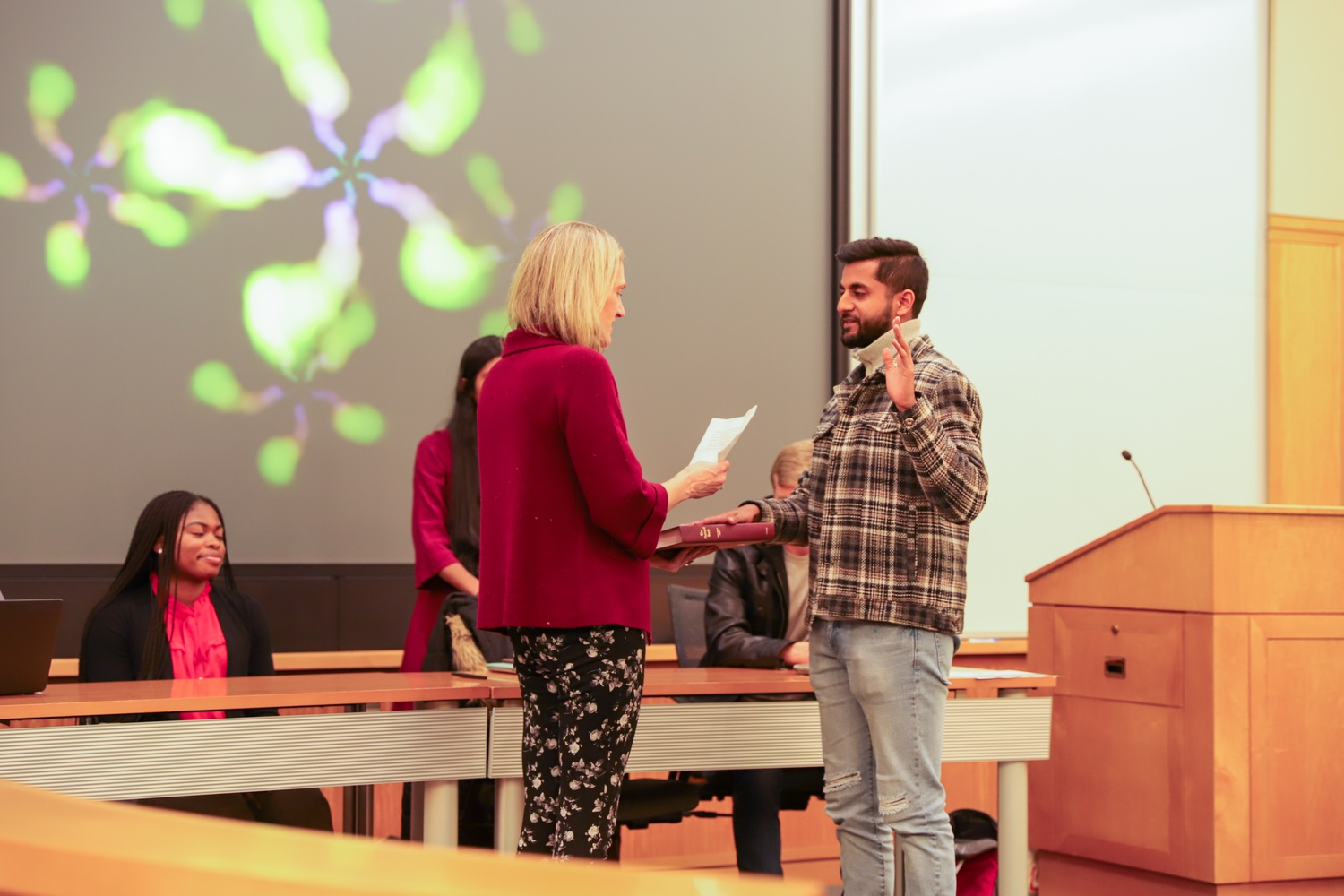 The incoming Undergraduate Council president, James A. Mathew '21, was formally inducted at the inauguration ceremony by Dean of Students Katherine G. O'Dair.