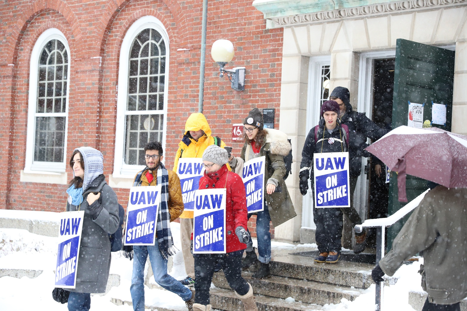 "Members of Harvard's graduate student union stream out of Phillips Brook House, which is serving as ""strike headquarters"" to start picketing in Harvard Yard."