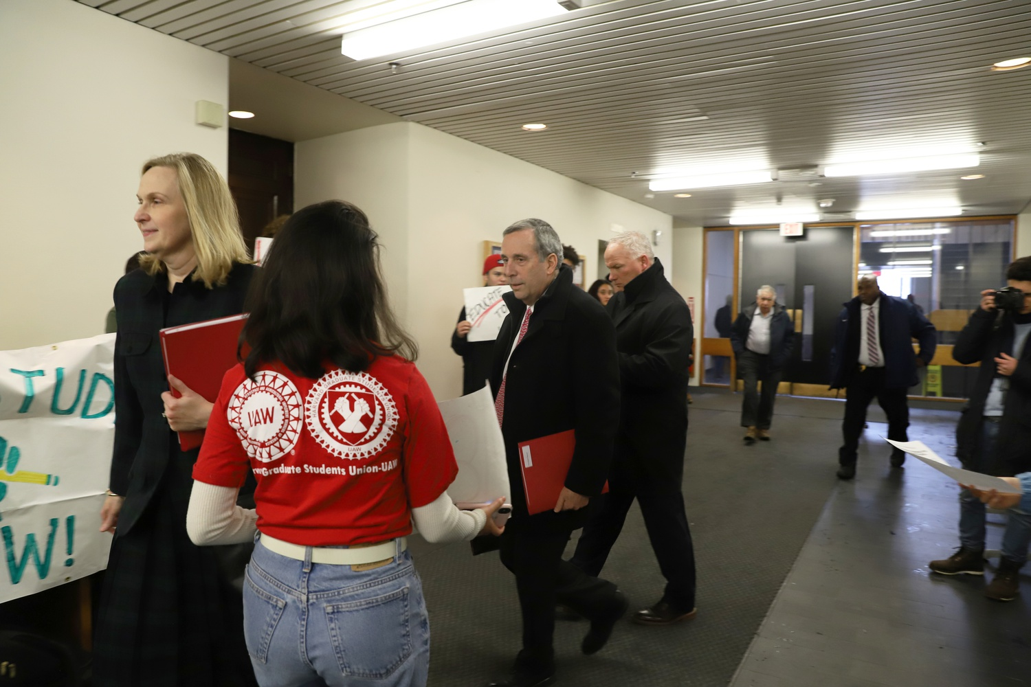 University President Lawrence S. Bacow faced protestors in Emerson Hall on his way to a faculty meeting Tuesday. Protestors decried the university's denial of tenure to Professor Lorgia García Peña.