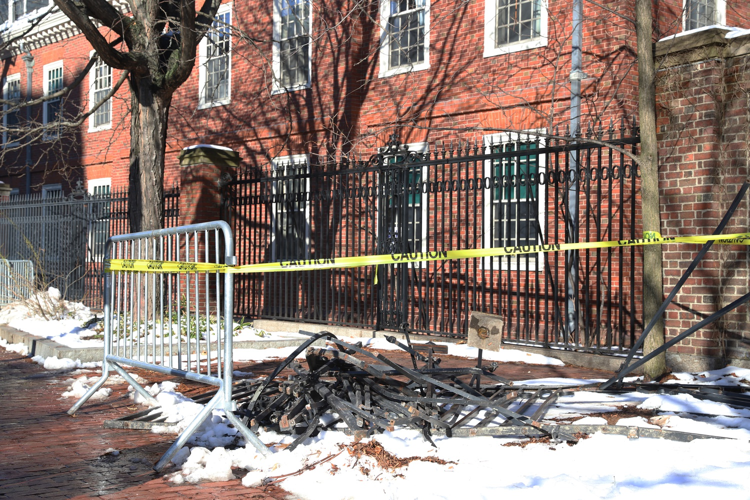 A driver died and a passenger received serious injuries after their car crashed through a fence on Mass. Ave. near Wigglesworth Hall.