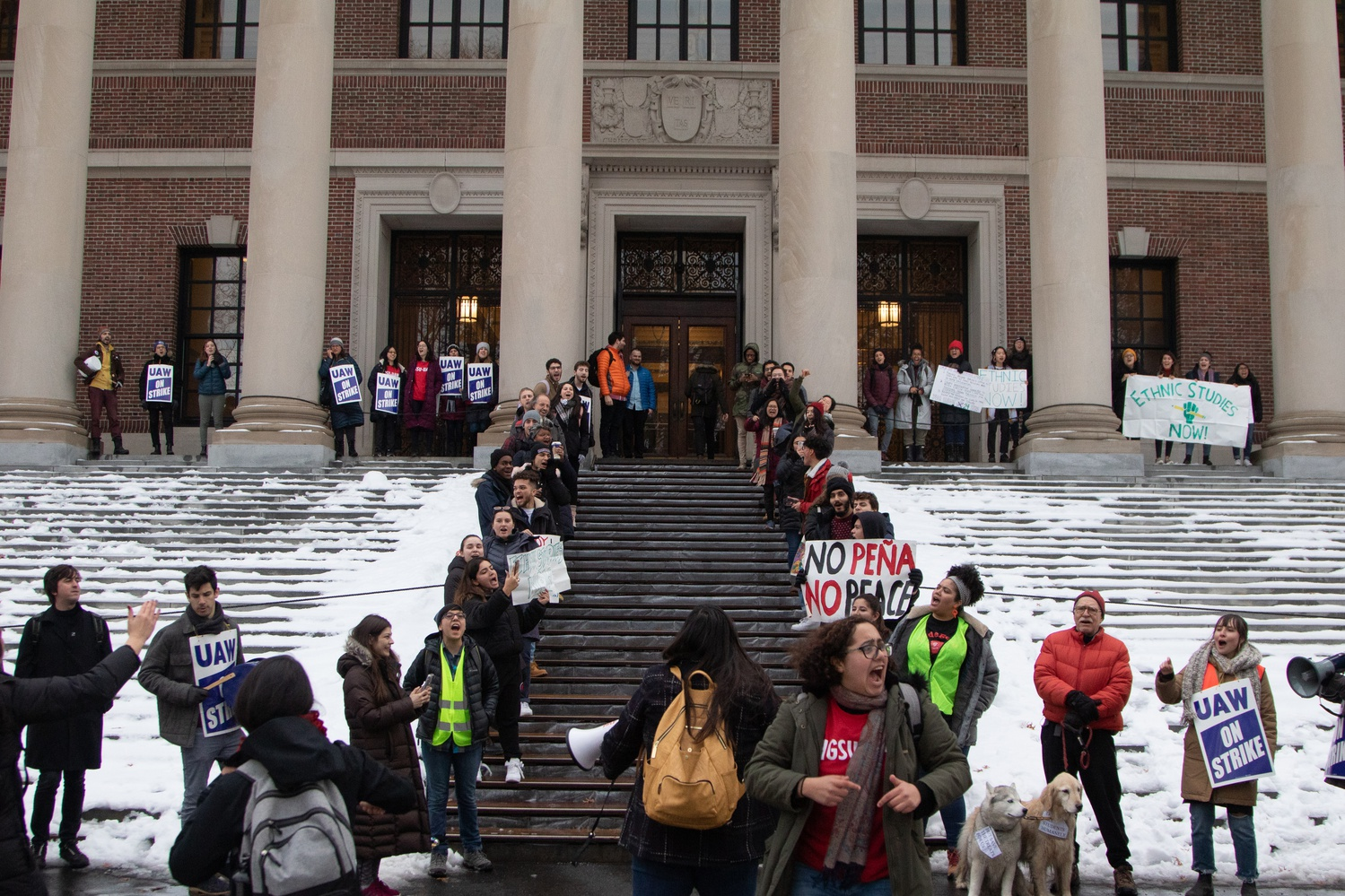 Students protested in front of Widener Library calling on Harvard to increase the number of Ethnic Studies faculty and to formalize the academic program.