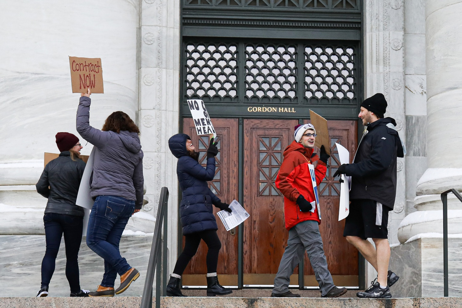 Picketers gathered outside of Gordon Hall on Harvard's Longwood campus as part of the graduate student union's strike.